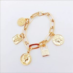 New gold colored coin lock chain bracelet